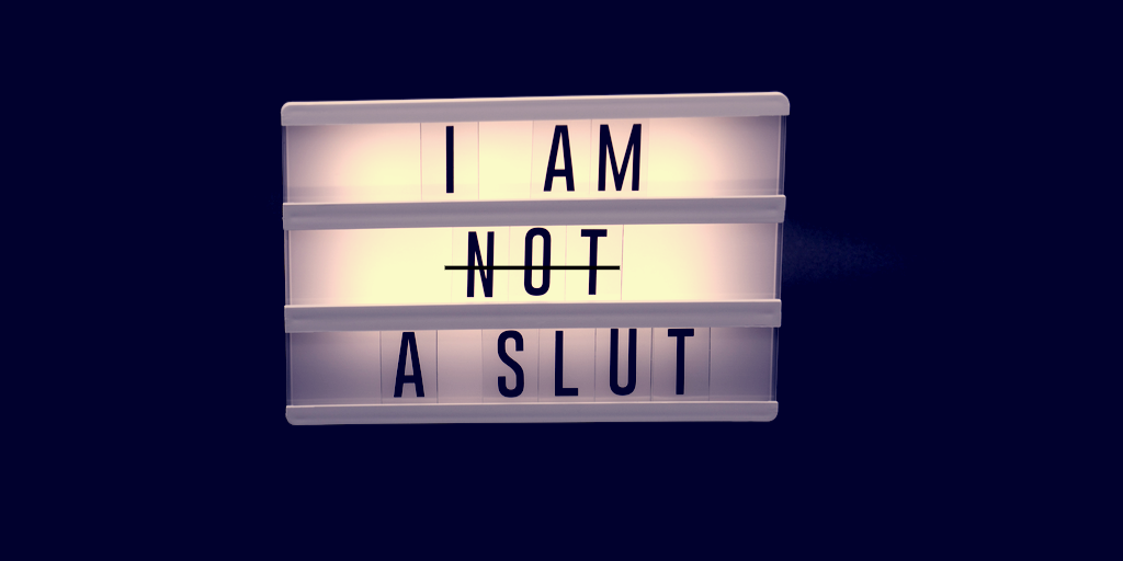 "Sign that says ""I Am Not a Slut"" but ""Not"" is crossed out"