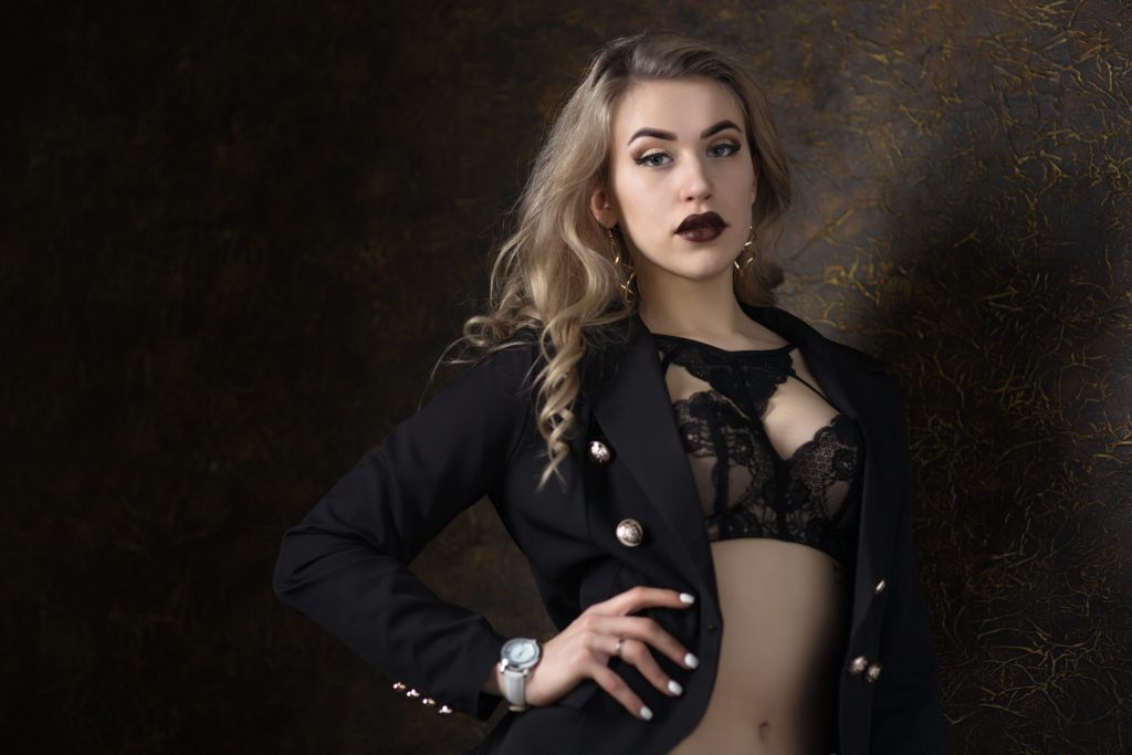 Woman wearing lingerie under a cropped jacket